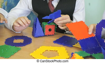 Little boy plays developing toy designer indoors -...