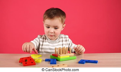 Little boy plays in developing game, education and daycare...