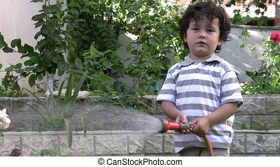 Little boy plays in the garden