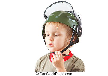 Little boy plays with helmet on a white background