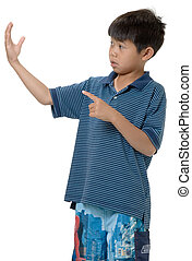 Little boy pointing at white space - cute Little asian boy ...