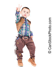 Little boy posing in cowboy costumes