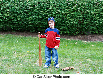 Little Boy Practicing His Baseball