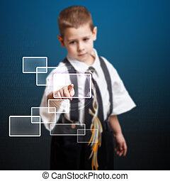 Little boy pressing high tech type