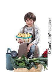 Little boy pretending to be a gardener