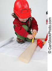 Little boy pretending to be builder