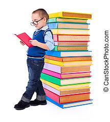 Little boy reading near big stack of books - Little wise boy...