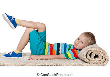 Little boy rests on the carpet