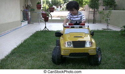 Little Boy rides car