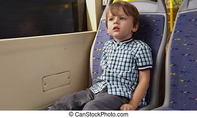 Little boy rides on public transport - boy rides on public...