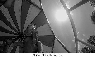 Little Boy Riding Carousel. Monochrome Shot