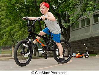 Little boy riding his bicycle