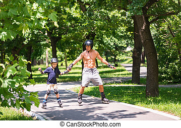 Little boy roller skating with his grandfather