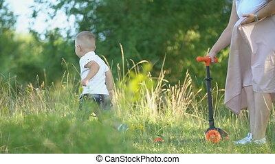 boy running across the lawn - little boy running across the...