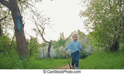 Little Boy Running along the Park Alley