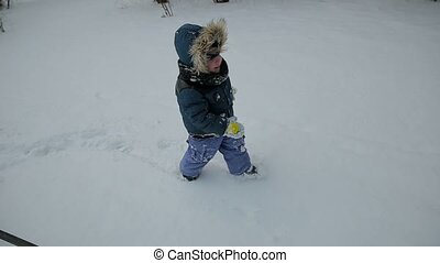 Little boy running through the snow