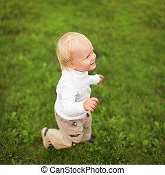 Little boy runs