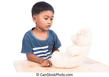 Little boy sad alone with old teddy bear