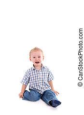 Little boy - sad child sitting on floor crying over white...
