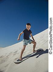 Little Boy Sand Boarding
