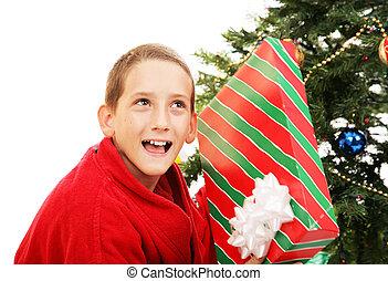 Little Boy Shaking Christmas Gift