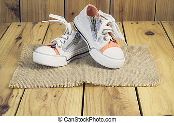 little boy shoes on wooden background