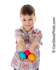 Little boy showing painted easter eggs