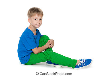 Little boy sits on the floor