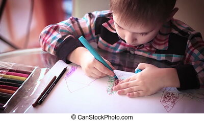 Little boy sitting at table and drawing7