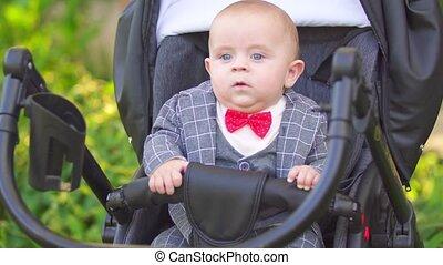 little boy sitting in a stroller
