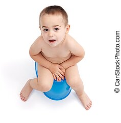 Little boy sitting on potty