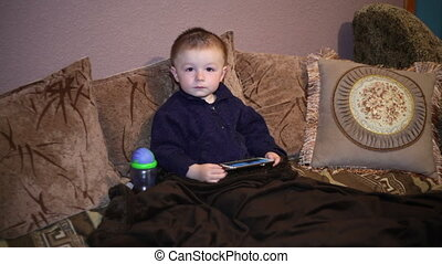 Little boy sitting on the couch