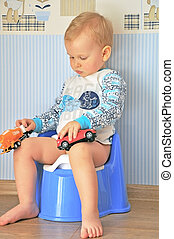 little boy sitting on the pot
