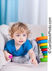 Little boy sitting on the sofa