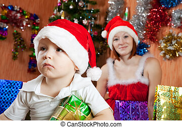boy sitting with Christmas gift
