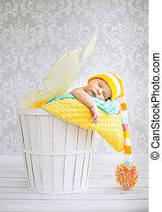 Little boy sleeping in the wicker basket