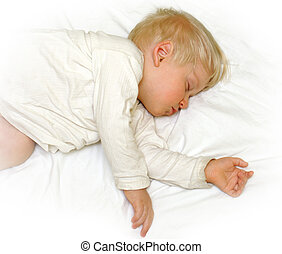 Little boy sleeping in white bedclothes