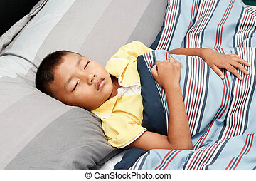 Little boy sleeping .