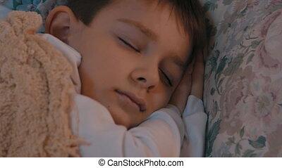 little boy sleeps in the nursery. - boy sleeps in the...