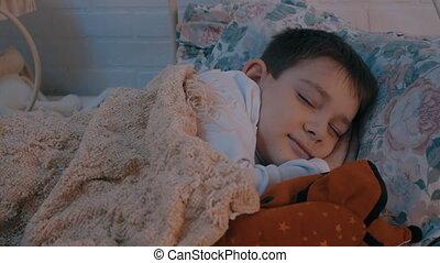 little boy sleeps in the nursery.