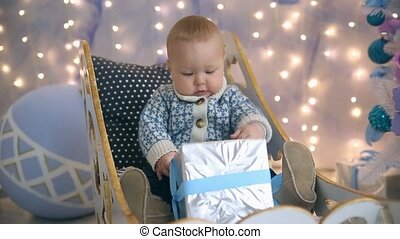 Little boy sleigh Christmas and gift