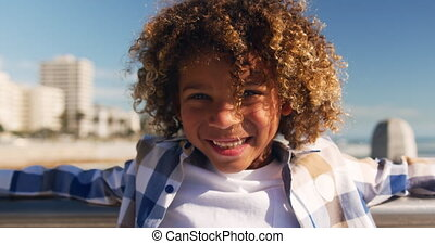 Little boy smiling and looking at camera