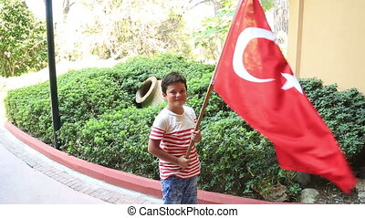 Little boy smiling and waving Turkish flag - Portrait of a...