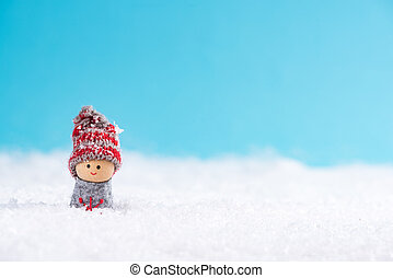 Little boy smiling in snow