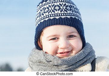 Little boy smiling portrait in winter. Happy child