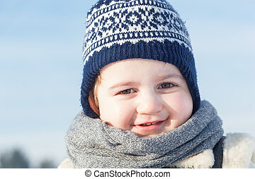 Little boy smiling portrait in winter. Happy child