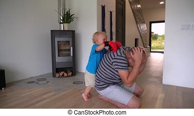 Little Boy Son In Boxing Gloves Playing With His Dad Father. Gimbal motion