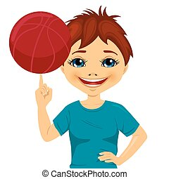 Little boy spinning basketball ball with his finger