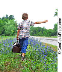 Little boy standing about road
