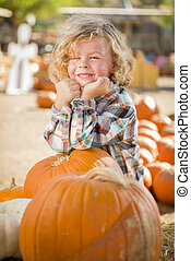 Little Boy Standing in a Rustic Ranch Setting at the Pumpkin Patch.